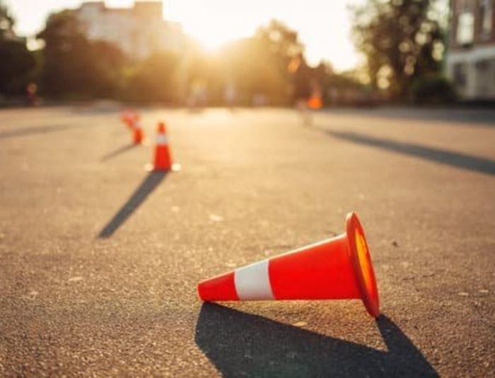 canva-fallen-cone-on-training-ground,-driving-school-MADapNWJYgM
